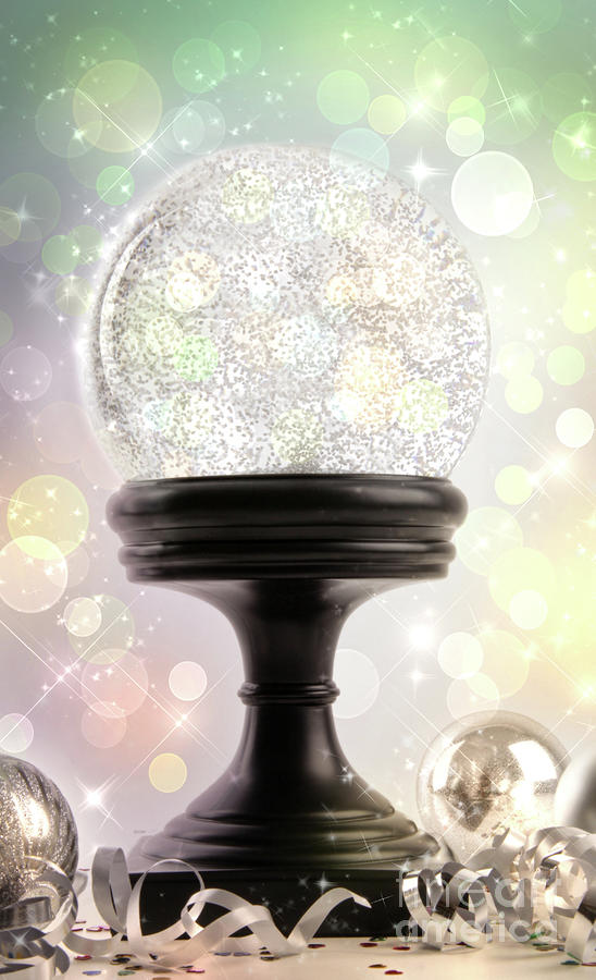 Snowglobe With Ornaments Against Colored Background Photograph