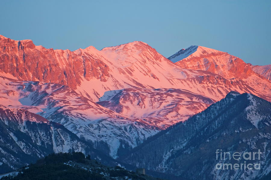 Snowy Mountain Range With A Rosy Hue At Sunset Photograph