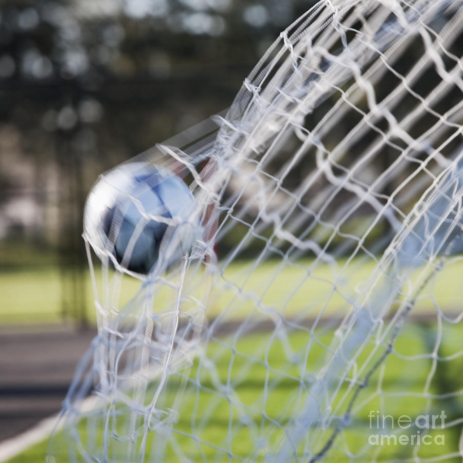 Soccer Ball In Goal Netting Photograph