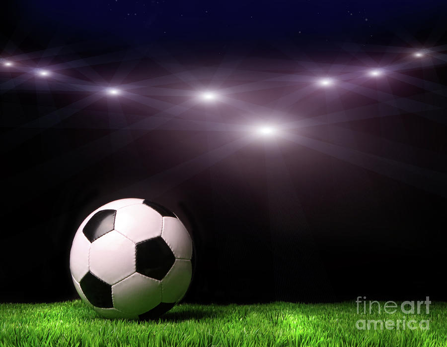 Soccer Ball On Grass Against Black Photograph