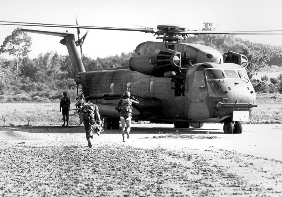 Soldiers Run To A Hh-53c Helicopter Photograph