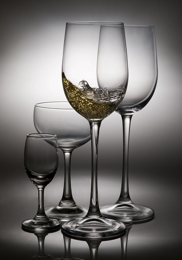 Splashing Wine In Wine Glasses Photograph