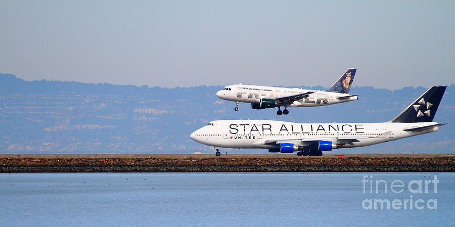 Star Alliance Airlines And Frontier Airlines Jet Airplanes At San Francisco Airport . Long Cut Photograph