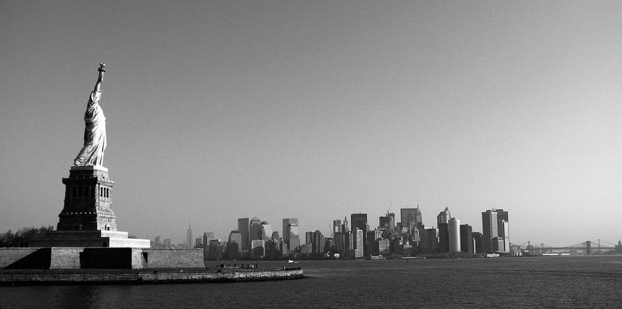 Statue Of Liberty Looking Over Manhattan Photograph