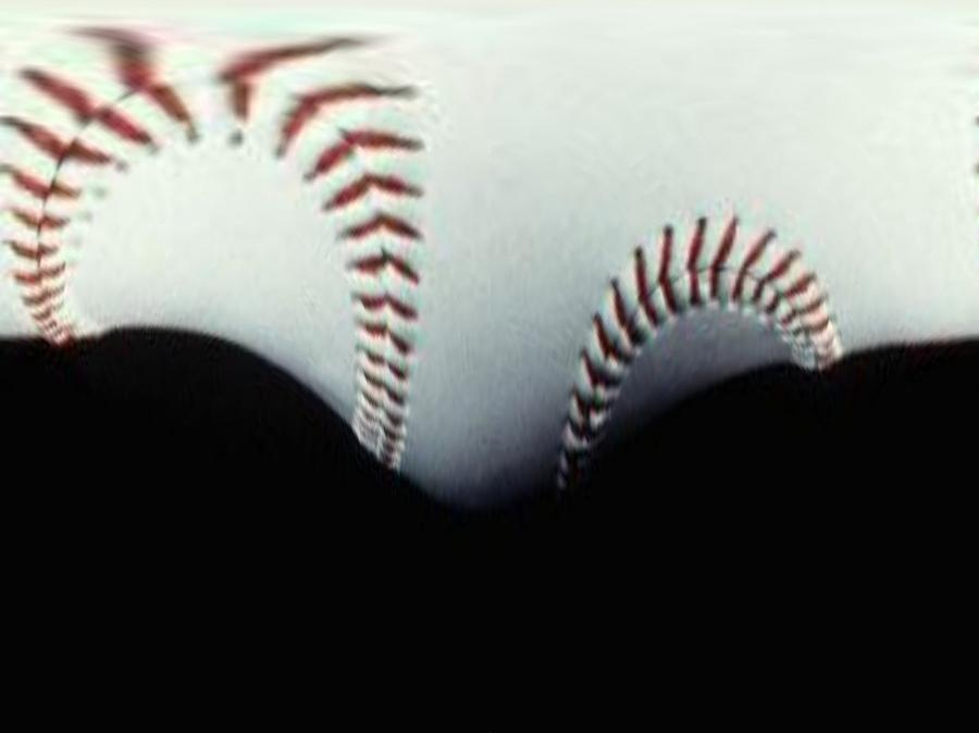 Stitches Of The Game Photograph