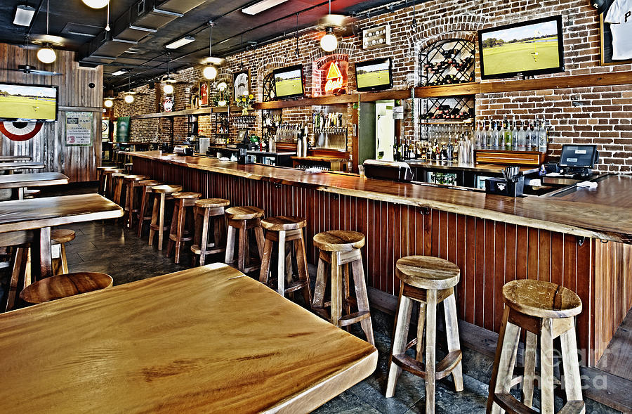 stools and counter in a sports bar photograph by skip nall