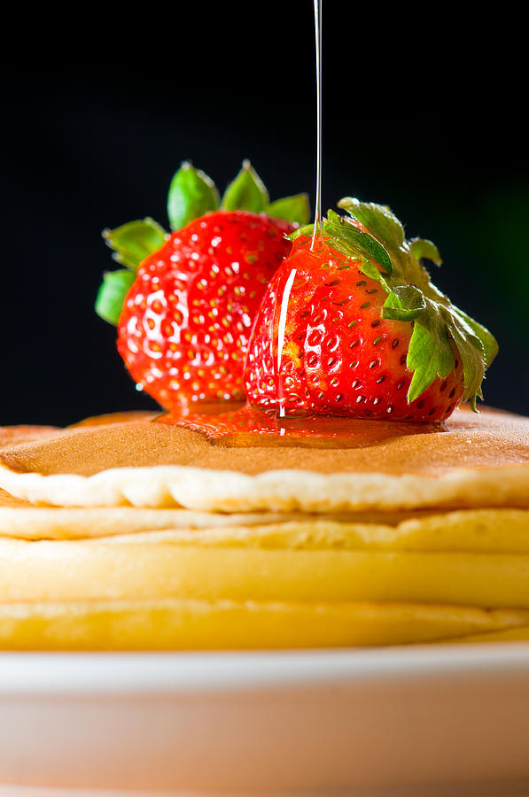 Strawberry Butter Pancake With Honey Maple Sirup Flowing Down Photograph