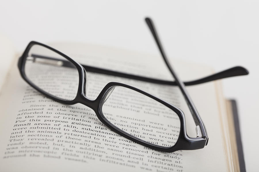 glasses on book - photo #6
