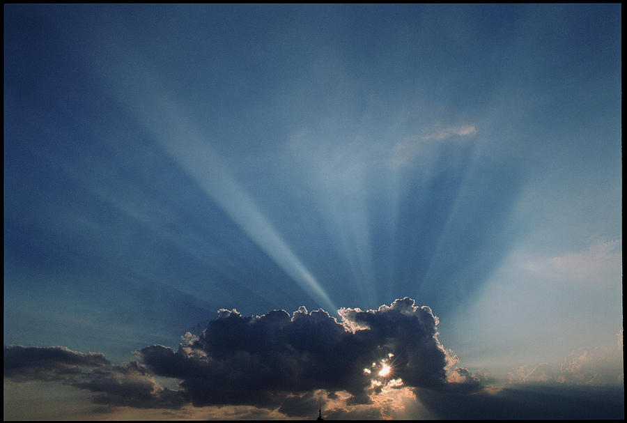 Sun Rays And Cumulus Cloud Photograph