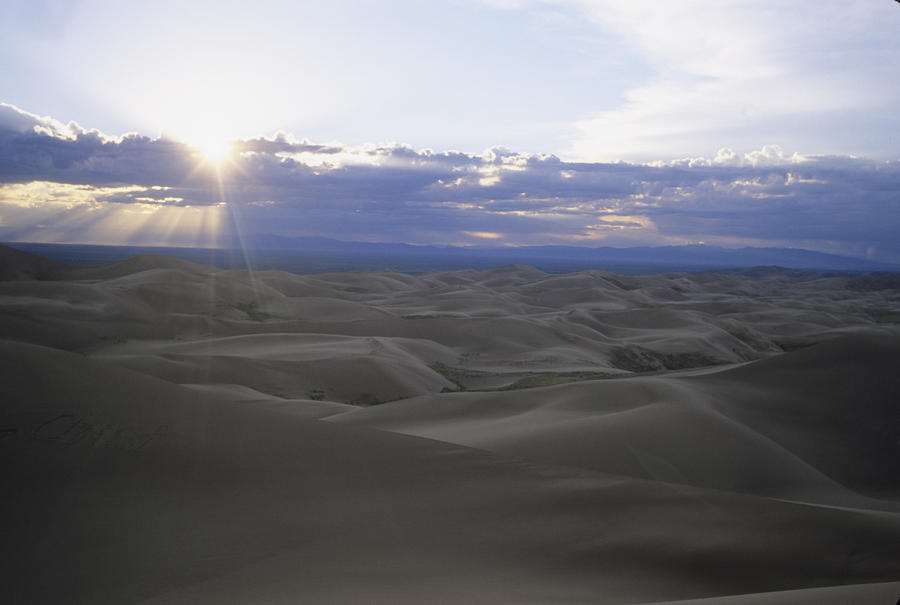 Sun Sets Over Miles Of Sand Dunes Photograph