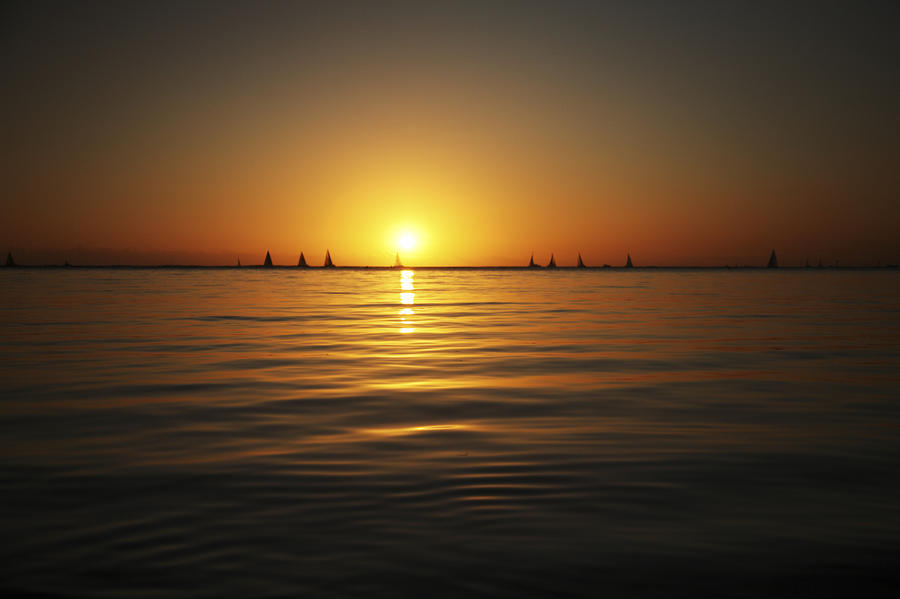 Sunset And Sailboats Photograph