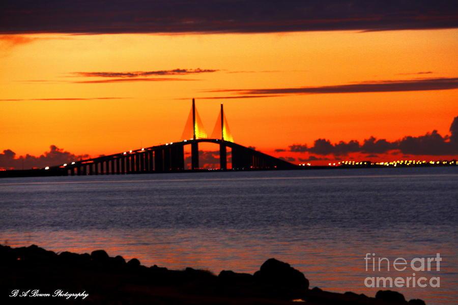 Sunset Over The Skyway Bridge Photograph