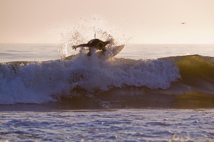 Surfer At Dusk Riding A Wave At Rincon Photograph