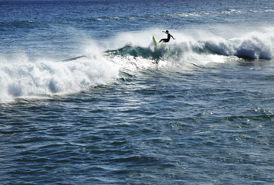 Surfer Riding A Wave Photograph