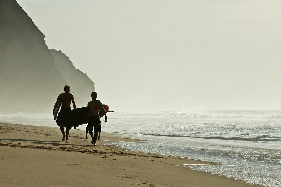 Beach Photograph - Surfers by Daniel Kulinski