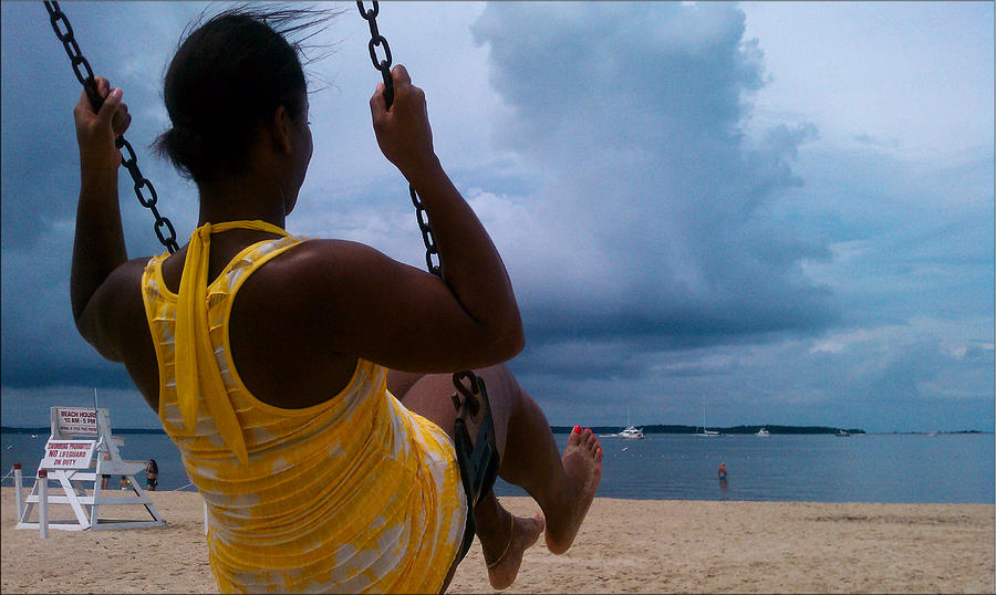 Swinging On A Stormy Sandy Beach Photograph