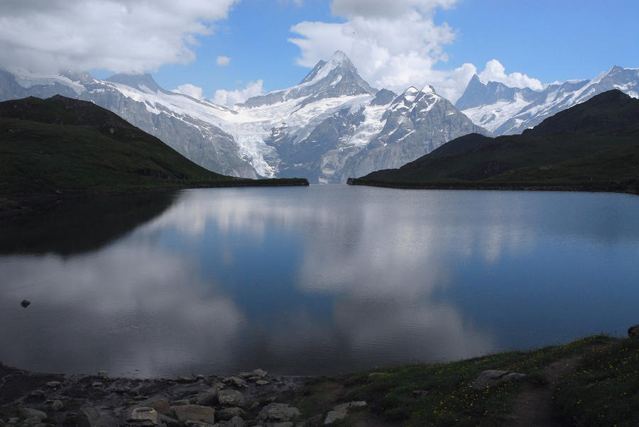 Swiss Alps And Clouds Casting Photograph