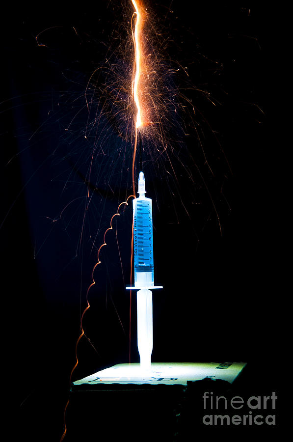 Syringe Disperses Lighting Photograph