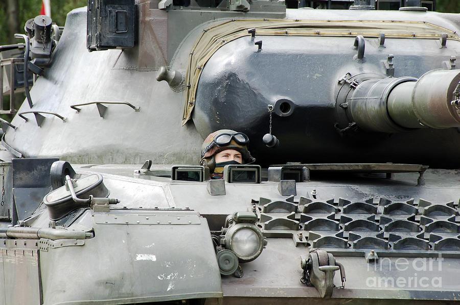 Armed Forces Photograph - Tank Driver Of A Belgian Leopard 1a5 by Luc De Jaeger