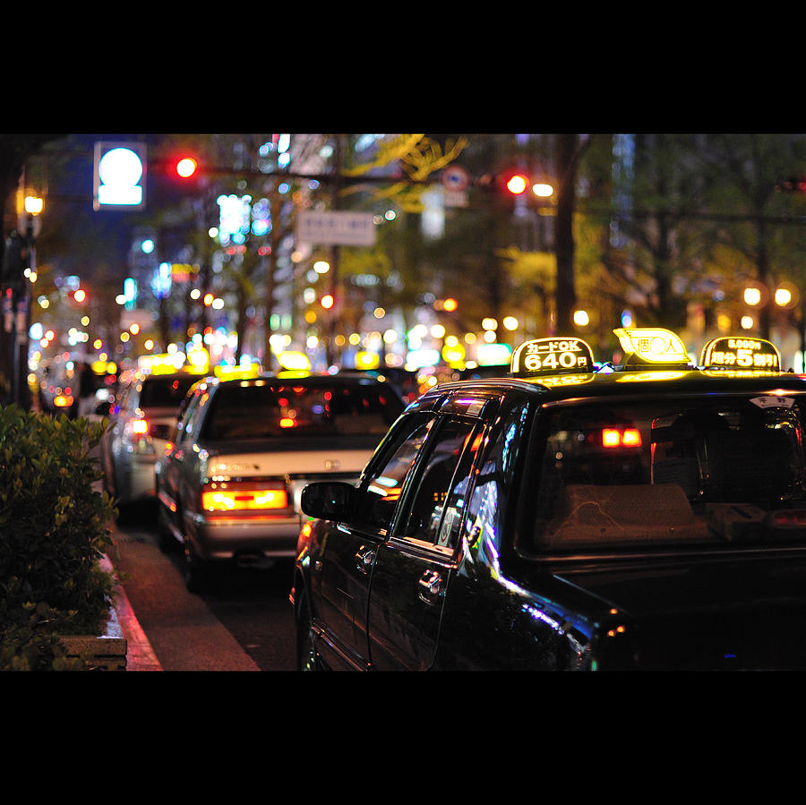 Taxis On Street At Night Photograph