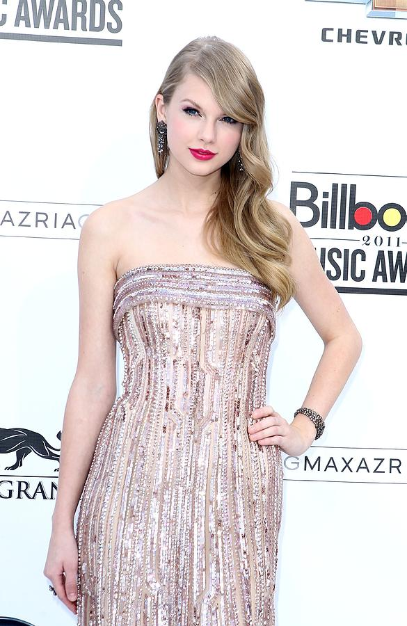 Taylor Swift Photograph - Taylor Swift Wearing An Elie Saab Gown by Everett