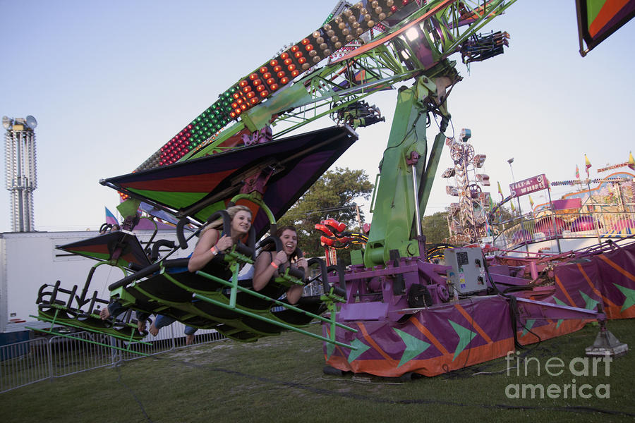 Teens On Thrill Rides At Church Festival Photograph