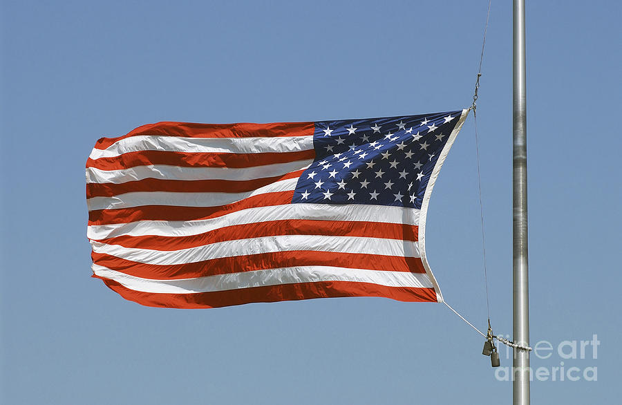 The American Flag Waves At Half-mast Photograph