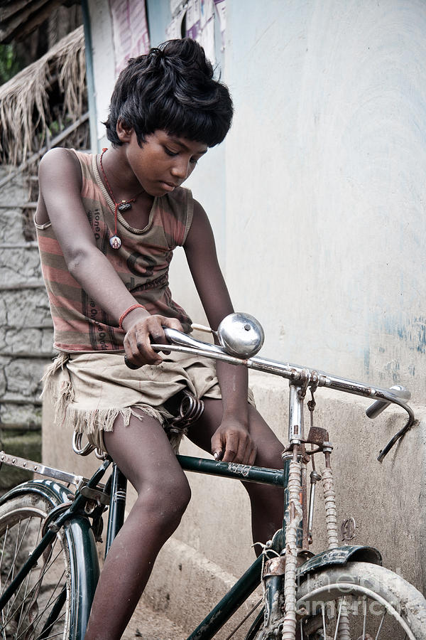 The Boy With The Bike Photograph