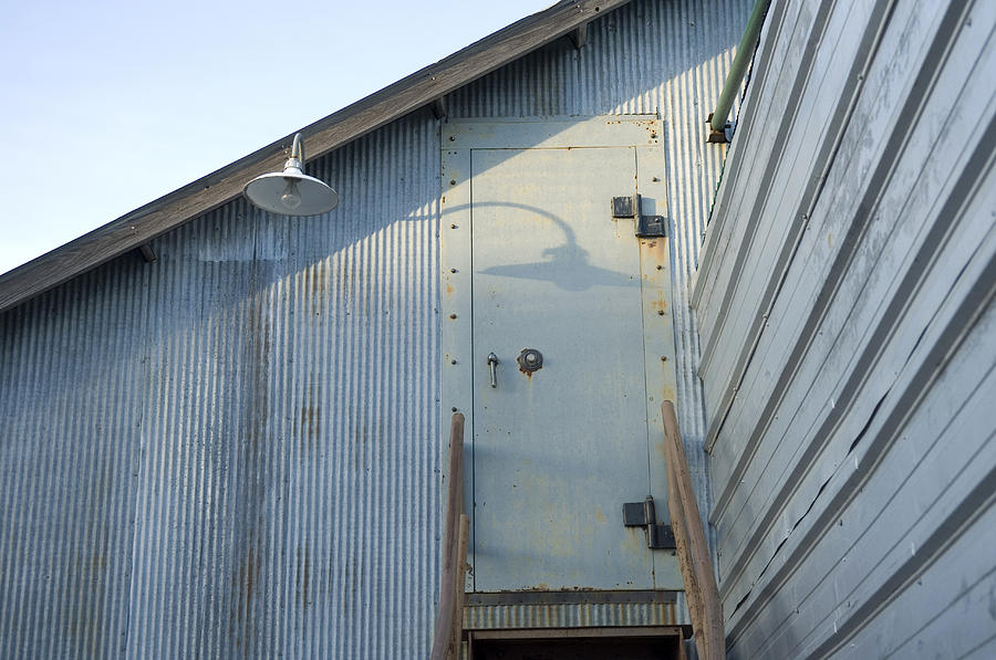 The Entry To A Metal Shed On A Sawmill Photograph