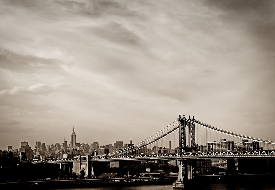 The New York City Skyline And The Manhattan Bridge Photograph