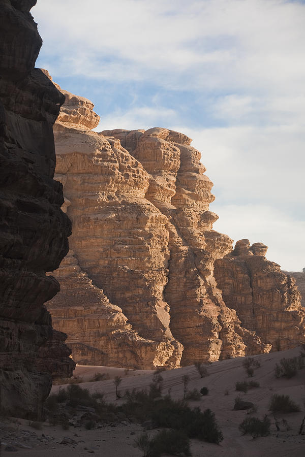 The Sandstone Cliffs Of The Wadi Rum Photograph