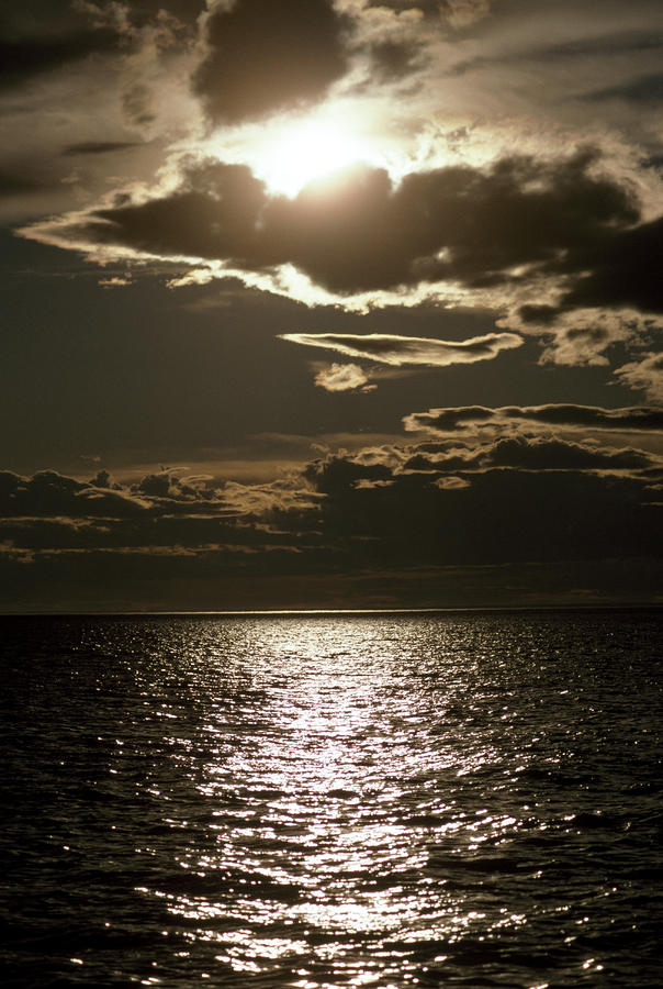The Setting Sun Pierces A Menacing Photograph