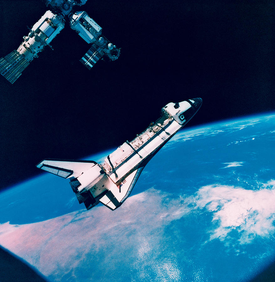 The Space Shuttle And Space Station In Orbit Above The ...