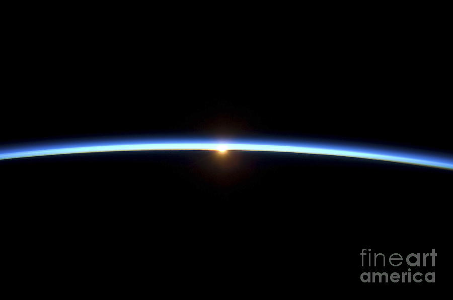 The Thin Line Of Earths Atmosphere Photograph