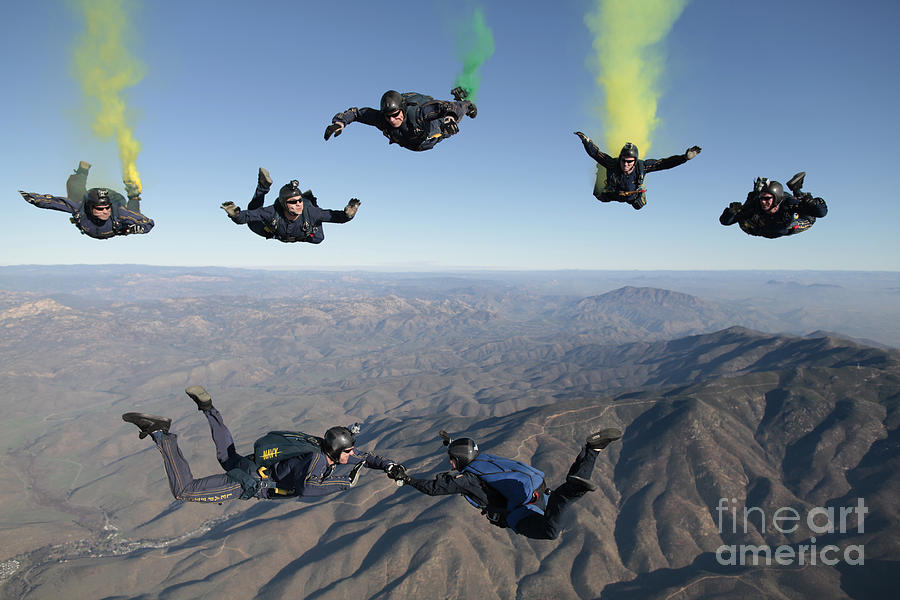 Skydiving Photograph - The U.s. Navy Parachute Demonstration by Stocktrek Images