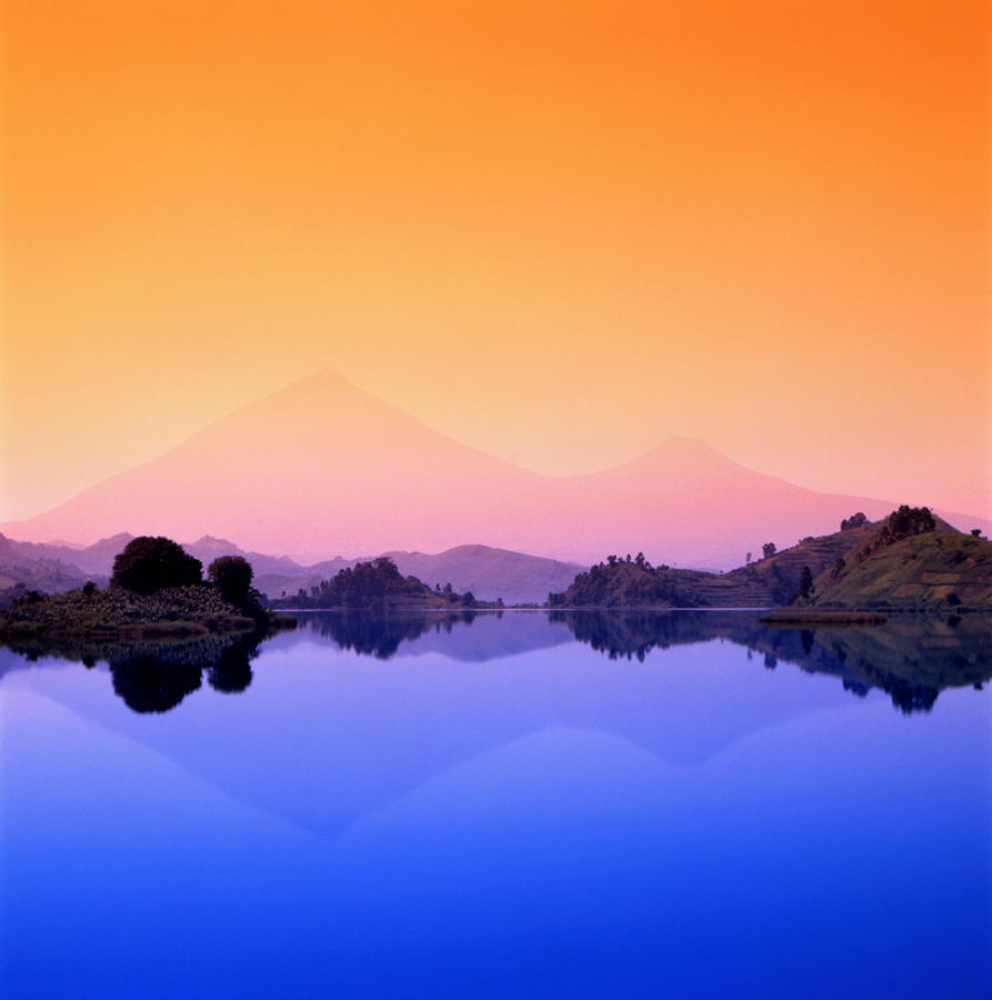 The Virunga Mountains Rise Above Lake Photograph