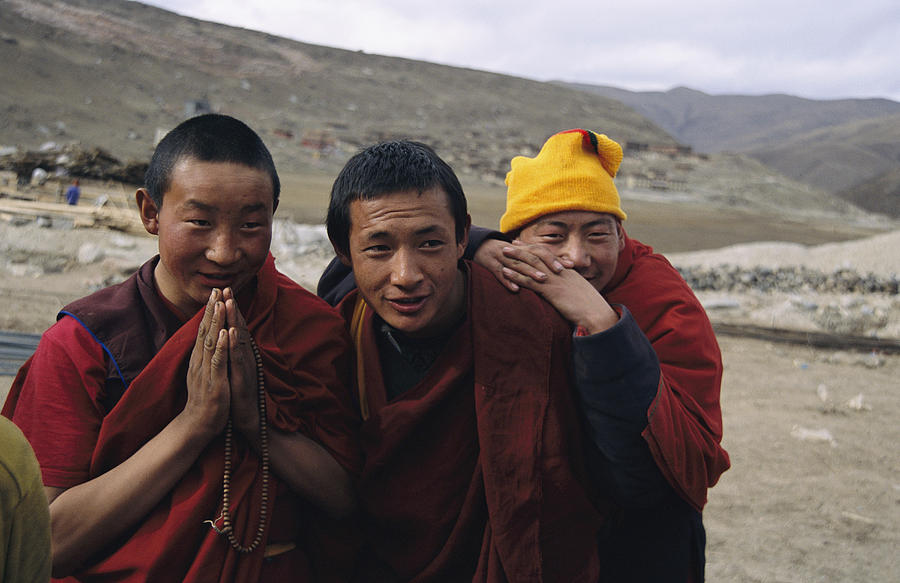 Three Buddhist Lamas In Gansu Province Photograph