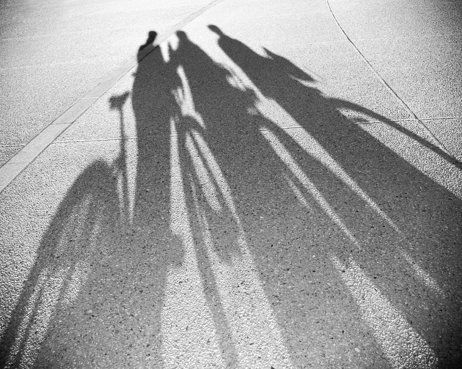 Three Friends On Bikes Photograph
