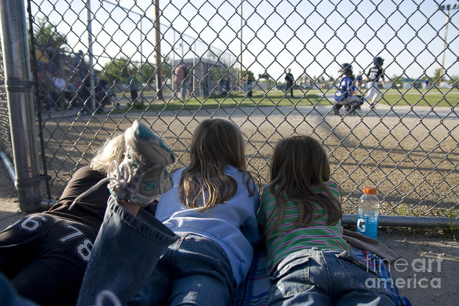 Three Girls Watching Ball Game Behind Home Plate Photograph