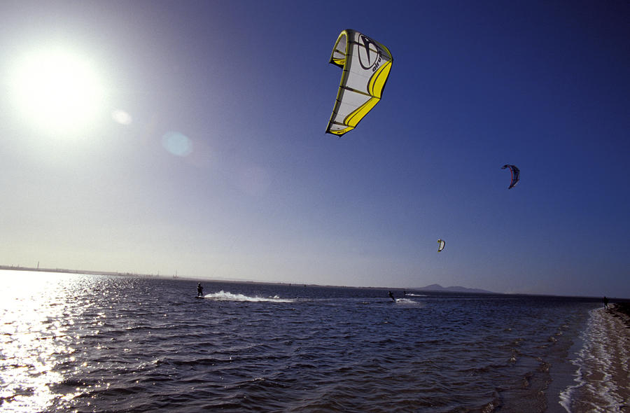 Three Kite Surfers On A Windy Summer Photograph