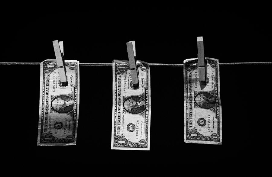 Three One Dollar Bill Banknotes Hanging On A Washing Line With Blue Sky Photograph