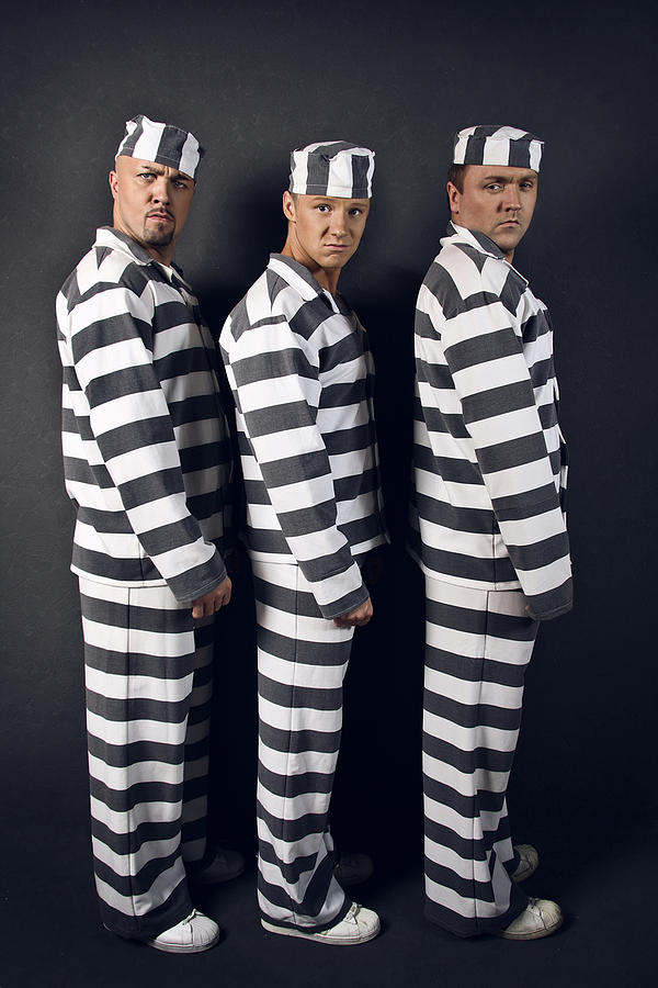 Three Prisoners. Group Of Men In Suits Of Convicts. Digital Art