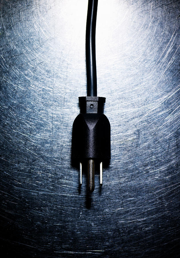 Three-pronged Electrical Plug On Stainless Steel. Photograph