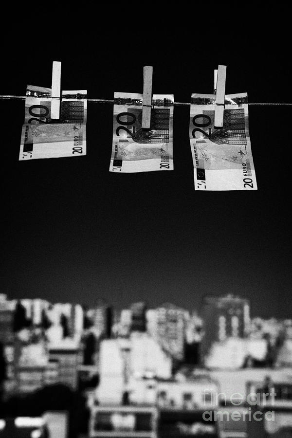 Three Twenty Euro Banknotes Hanging On A Washing Line With Blue Sky Over City Skyline Photograph  - Three Twenty Euro Banknotes Hanging On A Washing Line With Blue Sky Over City Skyline Fine Art Print
