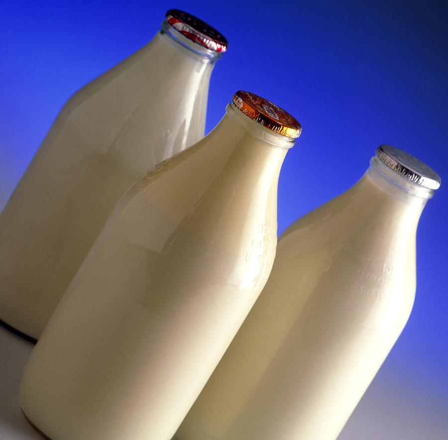 Three Types Of Bottled Milk Photograph
