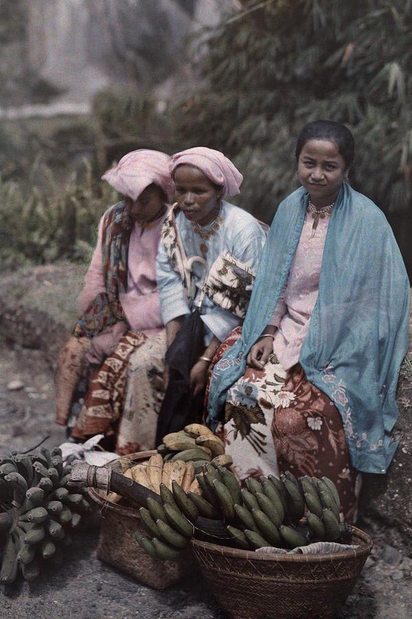 Three Women Traders Sit Photograph