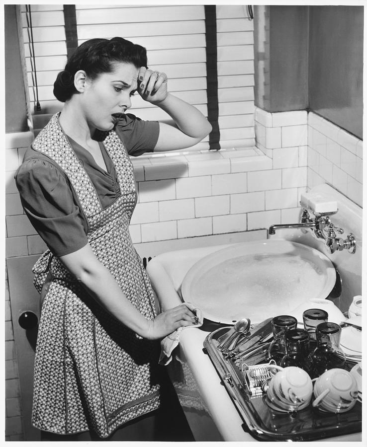 Tired Woman At Kitchen Sink, (b&w), Elevated View Photograph