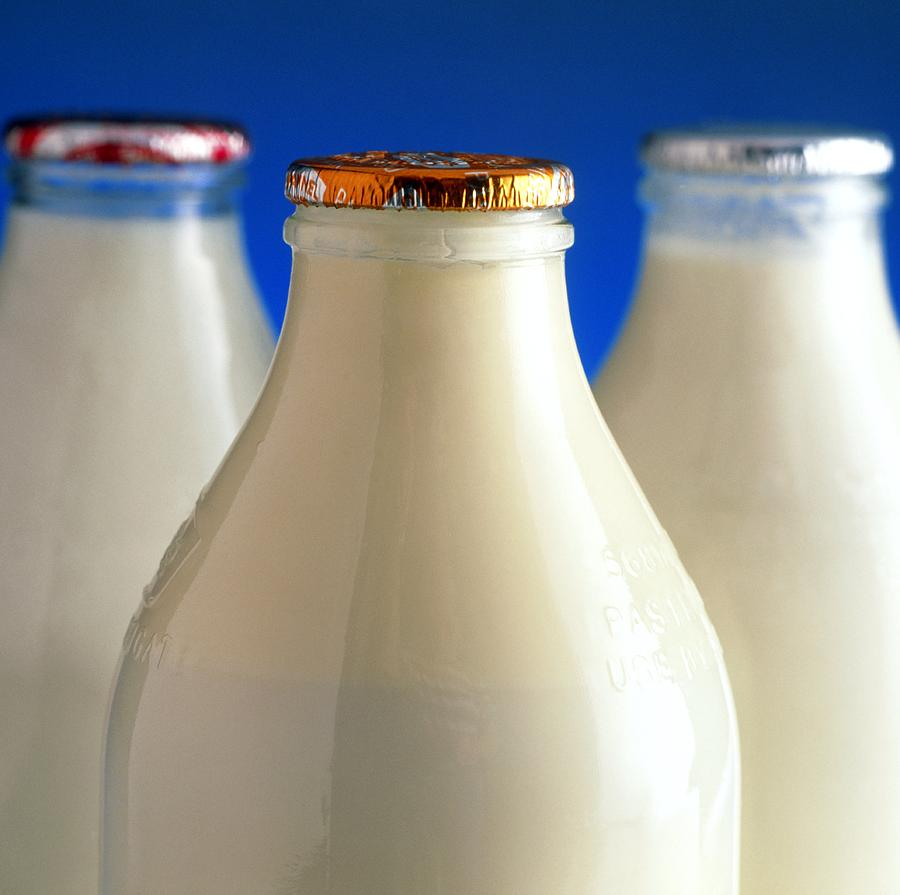 Tops Of Three Types Of Bottled Milk Photograph
