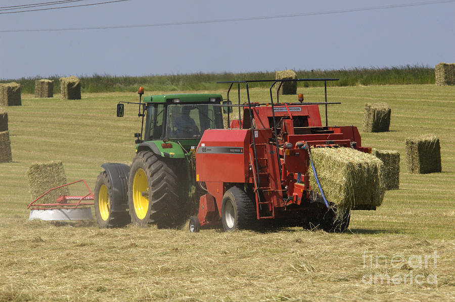 Tractor Bailing Hay At Harvest Time Photograph