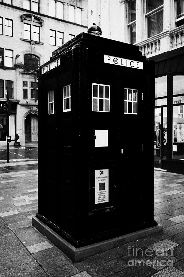 Traditional Photograph - traditional blue police callbox in merchant city glasgow Scotland UK by Joe Fox